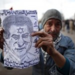 Poster of Hosni Mubarak with star of David held by Tahrir Square demonstrator (courtesy European Jewish Press)